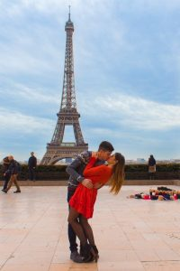 Kiss under the Eiffel tower, Paris.